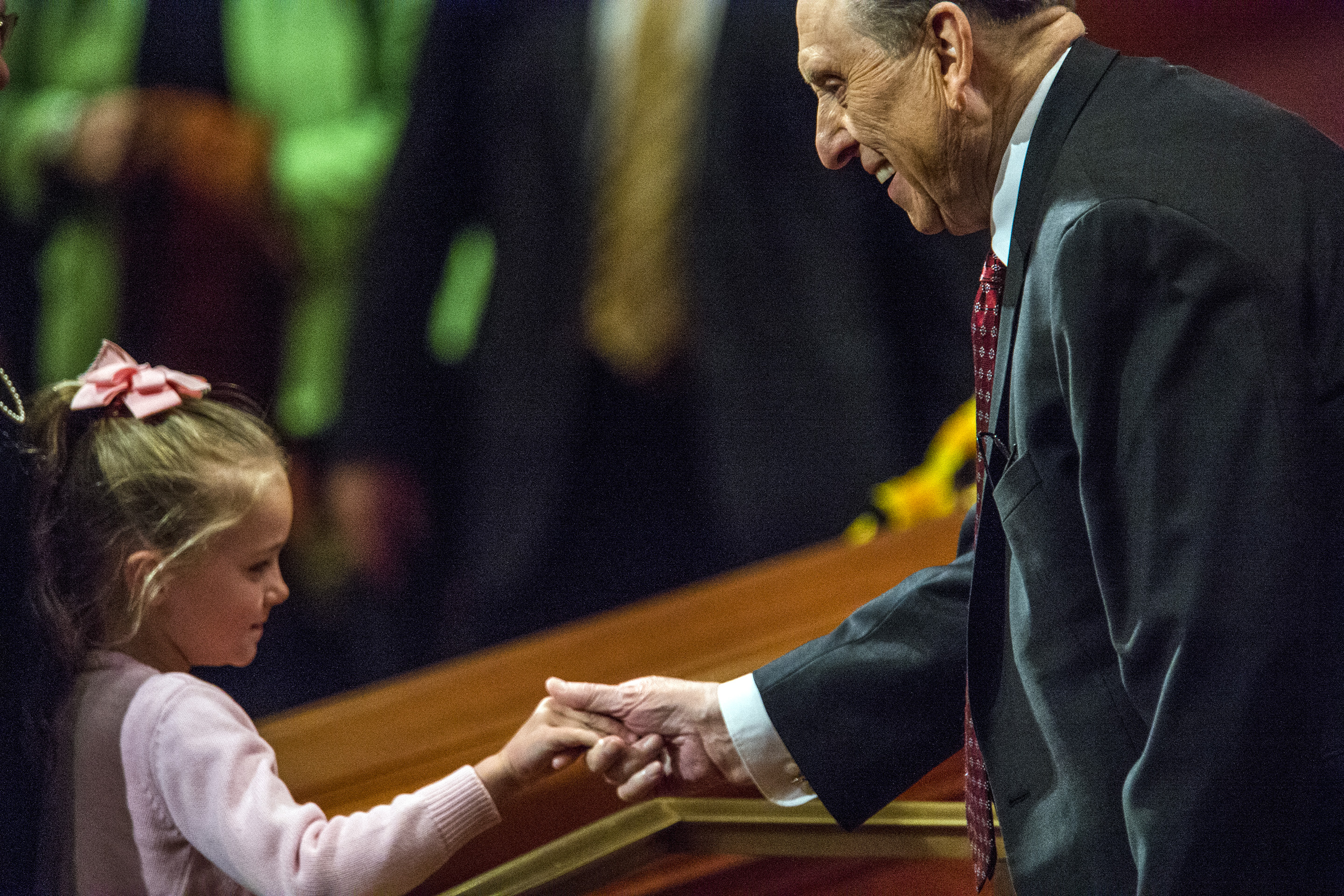 (Chris Detrick  |  The Salt Lake Tribune) President Thomas S. Monson greets a young girl during the morning session of the 184th Annual General Conference on April 5, 2014.