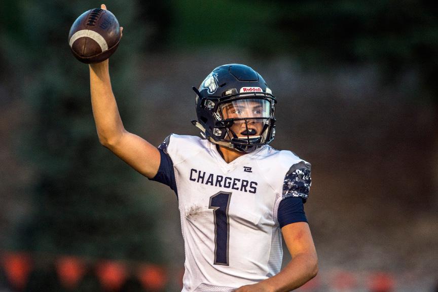 Chris Detrick  |  The Salt Lake Tribune Corner Canyon quarterback Zach Wilson celebrates during his team's 36-6 win over host Roy on Sept. 2, 2016.