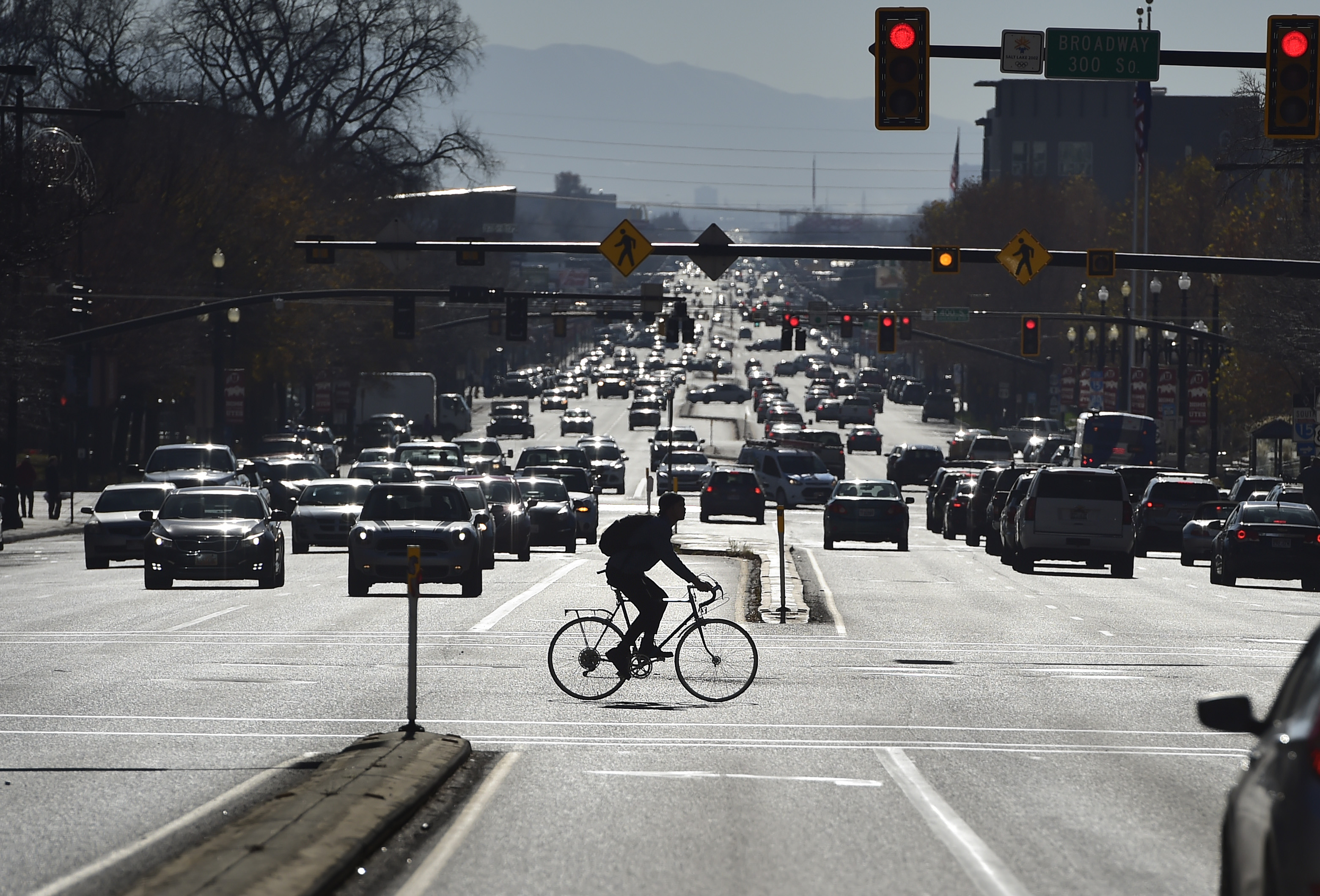 (Scott Sommerdorf   |  The Salt Lake Tribune)    A bicyclist braves downtown traffic on 300 South, while crossing State Street, Wednesday, Nov. 22, 2017.