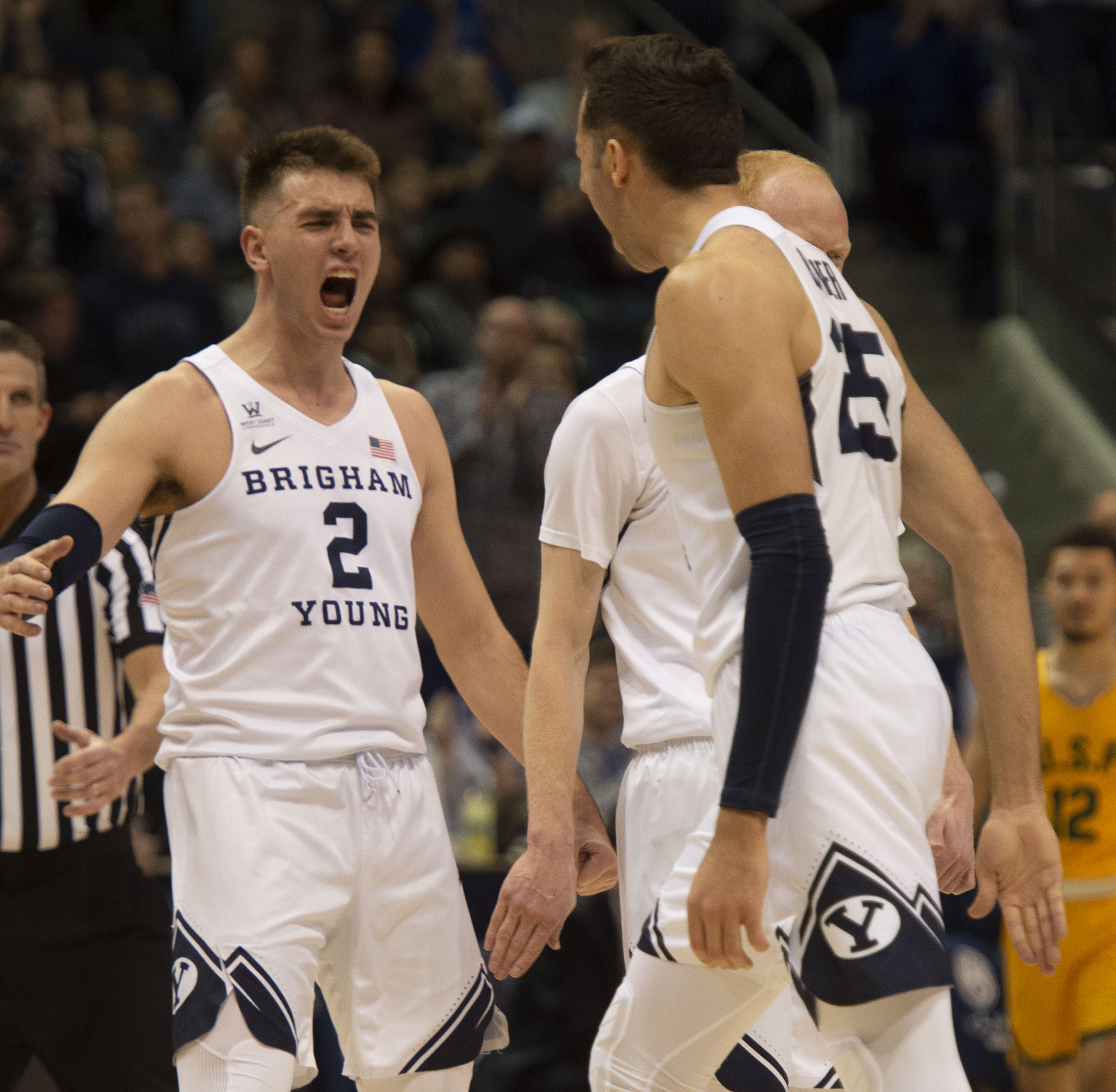 (Rick Egan  |  The Salt Lake Tribune)      Brigham Young guard Zac Seljaas (2) and  forward Gavin Baxter (25) celebrate a big Cougar lead with 10 minutes left in the game, in WCC basketball action between Brigham Young Cougars and San Francisco Dons, at the Marriott  Center, Thursday, February 21, 2018.